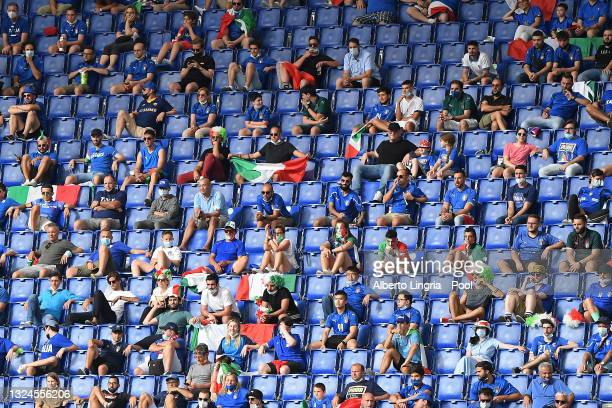 Fans of Italy are seen social distancing in the stands during the UEFA Euro 2020 Championship Group A match between Italy and Wales at Olimpico...