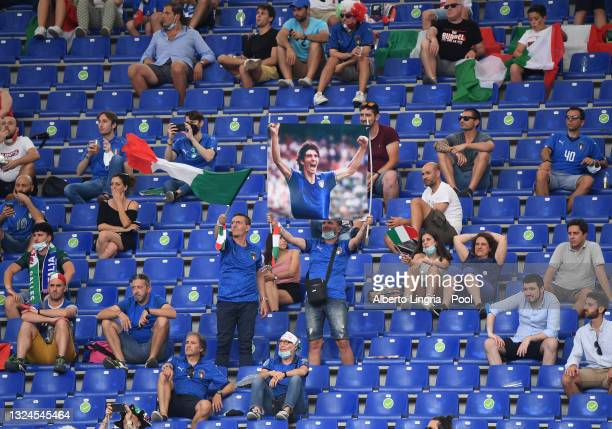 Fans of Italy hold up a flag of Former Italian International, Paolo Rossi prior to the UEFA Euro 2020 Championship Group A match between Italy and...