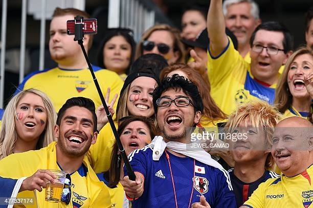 Fans of Japan and Ecuador soccer teams take a selfie at the Winnipeg Stadium before the start of the Group C football match of the 2015 FIFA Women's...