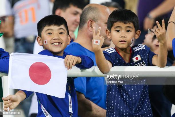 Fans of Japan celebrate the victory after the AFC Asian Cup Group F match between Japan and Uzbekistsn at Khalifa Bin Zayed Stadium on January 17...