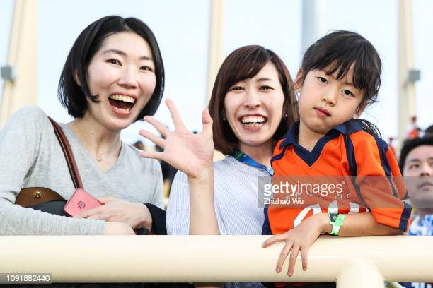 Fans of Japan celebrate the victory after the AFC Asian Cup Group F match between Japan and Turkmenistan at Al Nahyan Stadium on January 9, 2019 in...