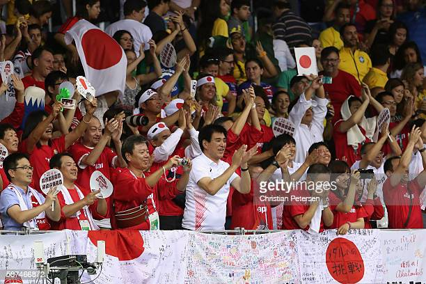 Fans of Japan cheer following the women's basketball game against Brazil on Day 3 of the Rio 2016 Olympic Games at the Youth Arena on August 8, 2016...