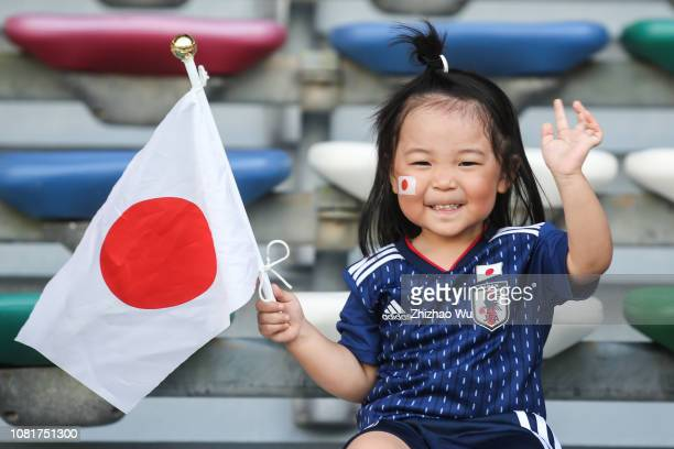Fans of Japan cheers during the AFC Asian Cup Group F match between Oman and Japan at Zayed Sports City Stadium on January 13 2019 in Abu Dhabi...