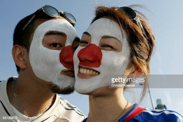 Fans of Japan kiss before the match between Japan and Brazil for the Confederations Cup 2005 at the RheinEnergie Stadium on June 22 2005 in Cologne...