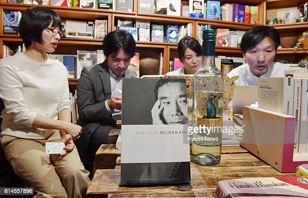 Fans of Japanese novelist Haruki Murakami look downcast at a Tokyo cafe on Oct 13 as the 67yearold author missed out on winning the Nobel Prize in...