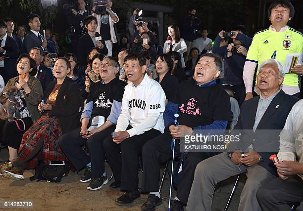 TOPSHOT Fans of Japanese novelist Haruki Murakami react when the Swedish Academy awarded the Nobel prize for literature to US musician Bob Dylan at a...