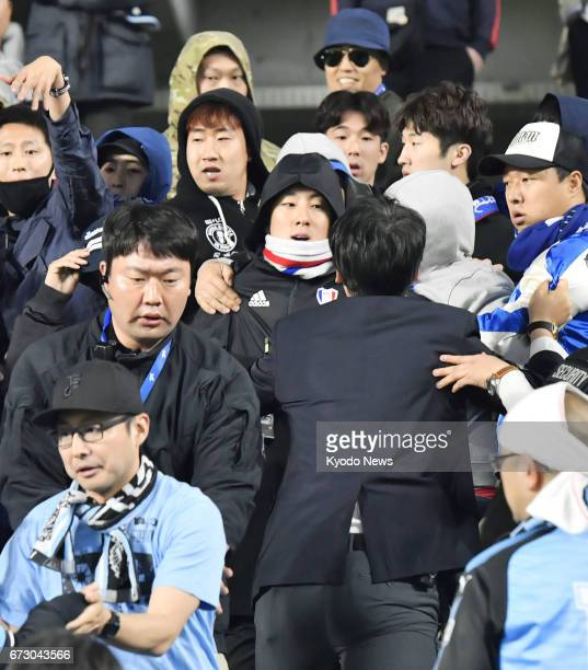 Fans of Japan's Kawasaki Frontale and South Korea's Suwon Bluewings exchange heated words after their Asian Champions League groupstage match in...