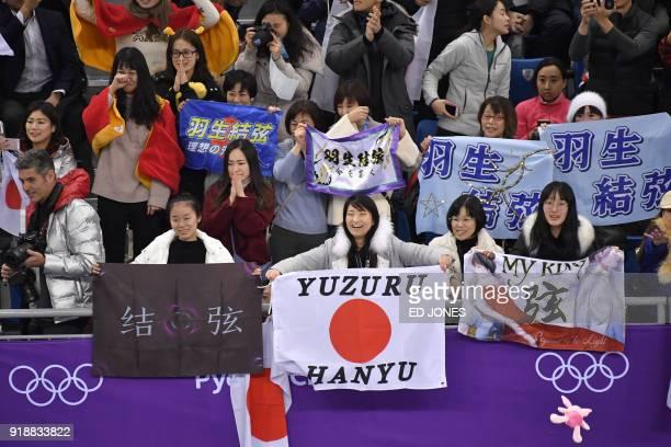 Fans of Japan's Yuzuru Hanyu cheer during the men's single skating short program of the figure skating event during the Pyeongchang 2018 Winter...