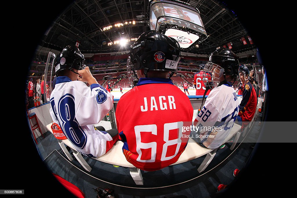 Fans of Jaromir Jagr #68 of the Florida Panthers sit on the bench and watch warm ups prior to the start of the game against the Washington Capitals at the BB&T Center on December 10, 2015 in Sunrise, Florida.