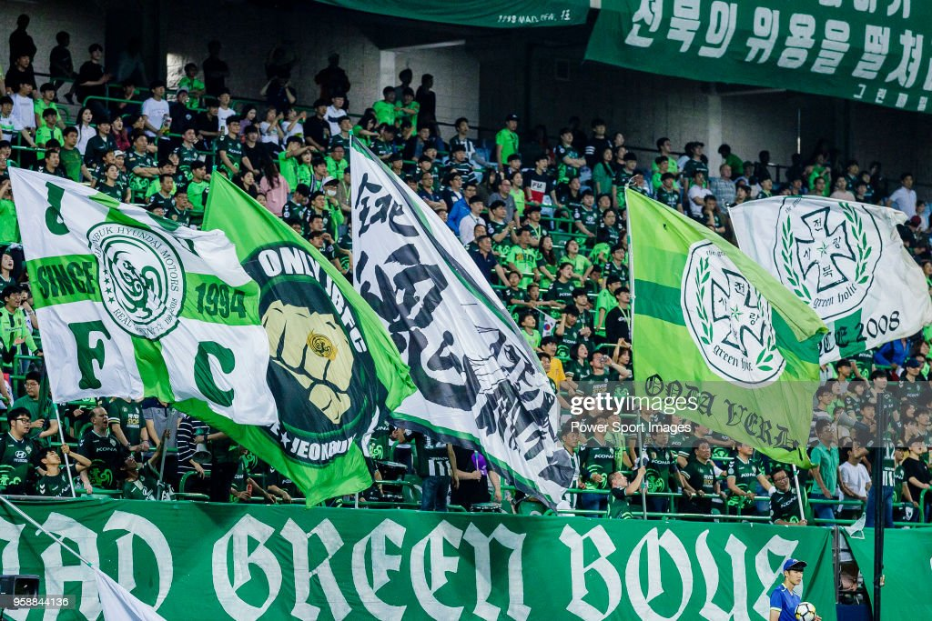 Fans of Jeonbuk Hyundai Motors FC cheer during the AFC Champions League 2018 Group F match between Jeonbuk Hyundai Motors FC (KOR) and Buriram United (THA) at Jeonju World Cup Stadium on 15 May 2018, in Jeonju, South Korea.