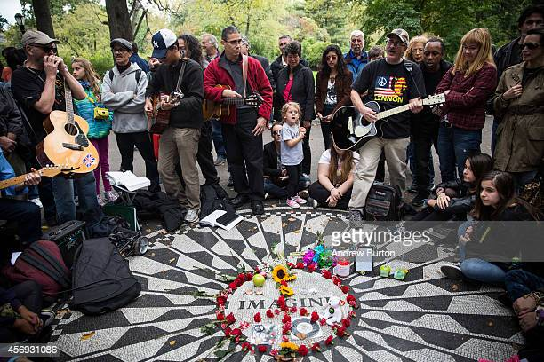 beatles fans remember john lennon on his 74th birthday at strawberry