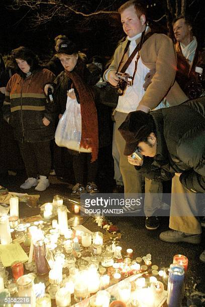 Fans of John Lennon view a memorial to the slain musician at a vigil in the Strawberry Fields section of Central Park in New York 08 December 2000...