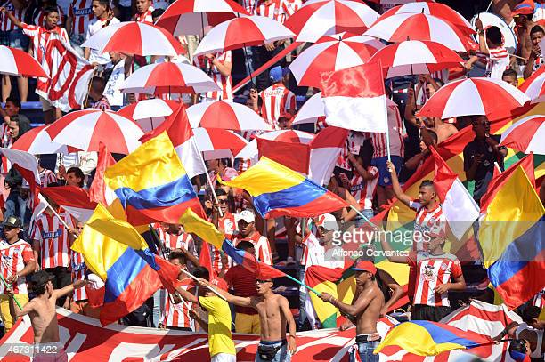 Fans of Junior cheer for their team during a match between Junior and Millonarios as part of 11th round of Liga Aguila I 2015 at Metropolitano...