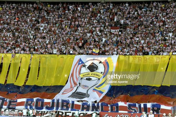 Fans of Junior cheer for their team during a second leg match between Junior and Cerro Porteño as part of round of 16 of Copa CONMEBOL Sudamericana...