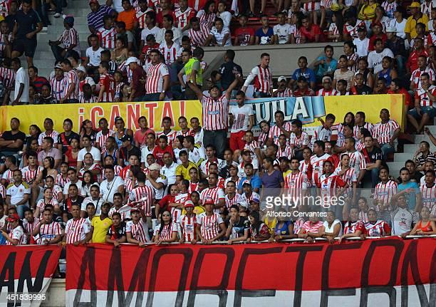 Fans of Junior support their team during a match between Junior and Nacional as part of the Liga Postobón II at Metropolitan Stadium Roberto Melendez...