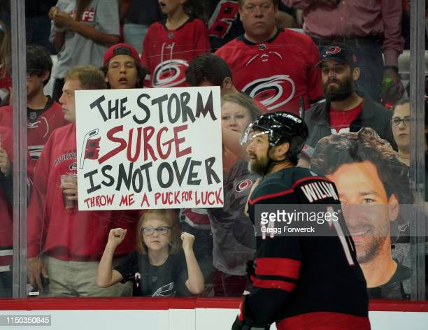 Fans of Justin Williams the Carolina Hurricanes celebrate during pregame warmups in Game Four of the Eastern Conference Third Round against the...