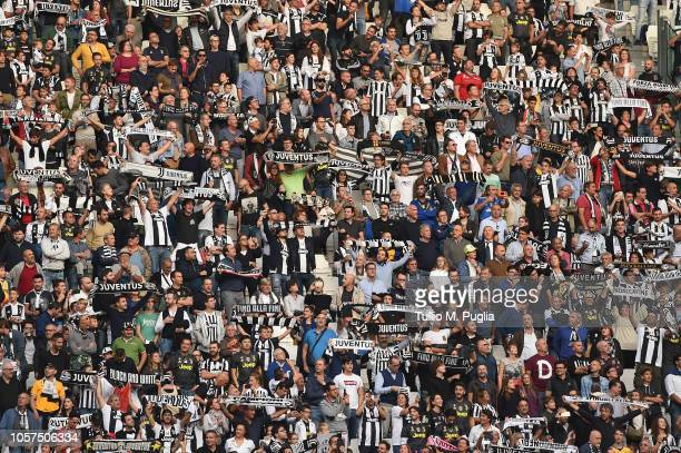 Fans of Juventus show their support during the Serie A match between Juventus and Genoa CFC at Allianz Stadium on October 20 2018 in Turin Italy