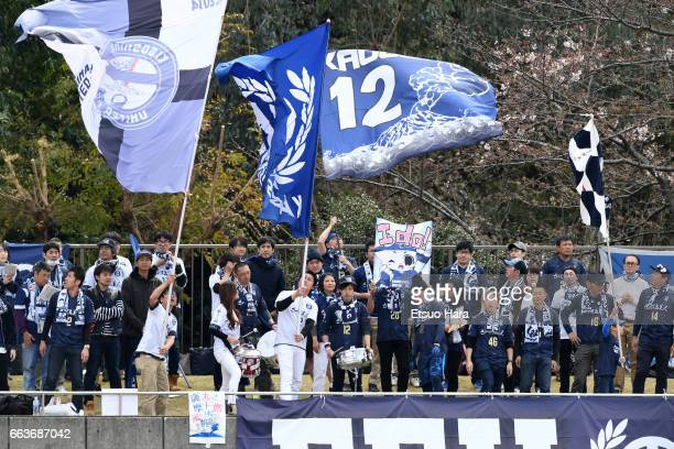 Fans of Kagoshima United cheer during the J.League J3 match between FC Tokyo U-23 and Kagoshima United at Yumenoshima Stadium on April 2, 2017 in...