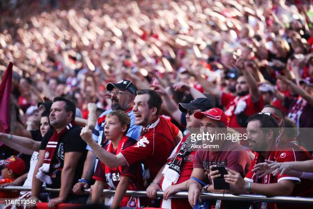 Fans of Kaiserslautern celebrate after the DFB Cup first round match between 1. FC Kaiserslautern and 1. FSV Mainz 05 at Fritz-Walter-Stadion on...
