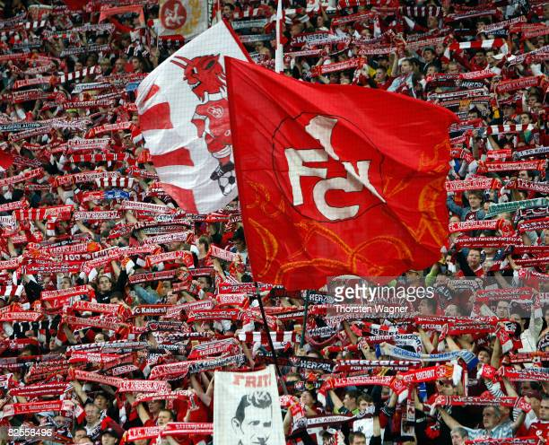 Fans of Kaiserslautern celebrate after the Second Bundesliga match between 1FC Kaiserslautern and 1FC Nuernberg at the FritzWalterStadium in...