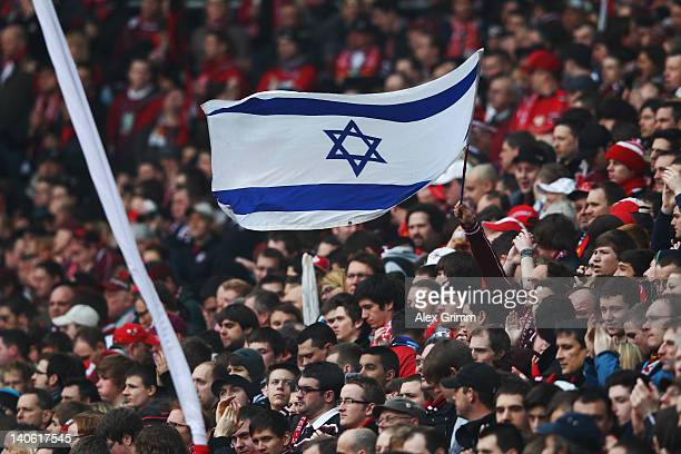 Fans of Kaiserslautern hold up an Israelian flag to protest against antisemitism prior to the Bundesliga match between 1 FC Kaiserslautern and VfL...