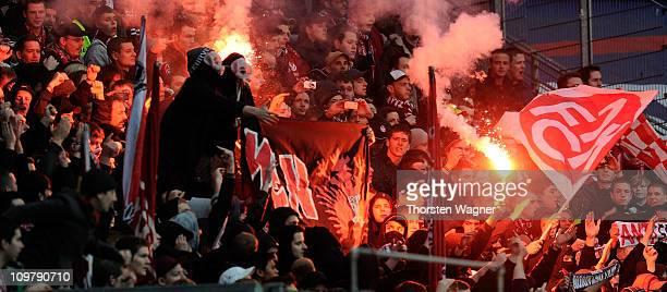Fans of Kaiserslautern light smoke bombs during the Bundesliga match between Eintracht Frankfurt and 1.FC Kaiserslautern at Commerzbank Arena on...