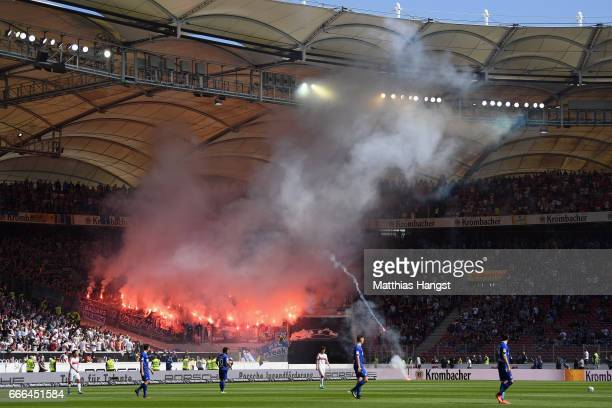 Fans of Karlsruhe burn flares during the Second Bundesliga match between VfB Stuttgart and Karlsruher SC at MercedesBenz Arena on April 9 2017 in...