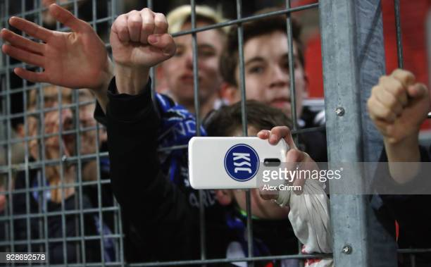 Fans of Karlsruhe celebrate after the 3 Liga match between Karlsruher SC and SG Sonnenhof Grossaspach at Wildparkstadion on March 7 2018 in Karlsruhe...