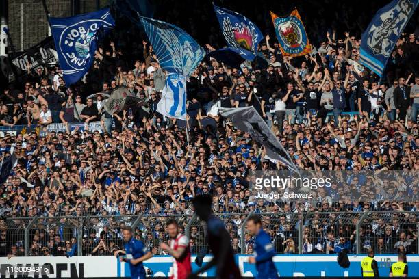 Fans of Karlsruhe support their team during the 3. Liga match between Karlsruher SC and 1. FC Kaiserslautern at Wildparkstadion on February 16, 2019...