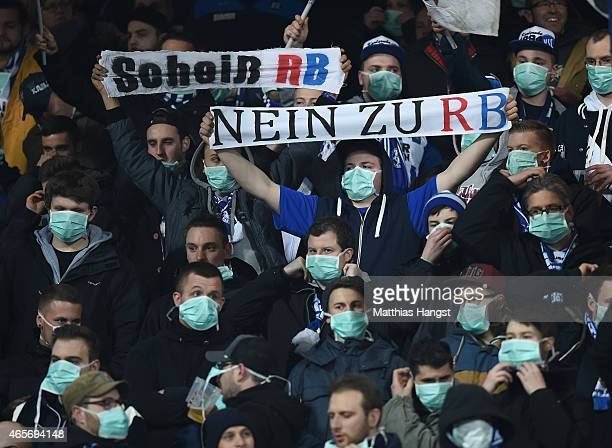 Fans of Karlsruher SC with masks protest against RB Leipzig prior to the Second Bundesliga match between Karlsruher SC and RB Leipzig at Wildpark...