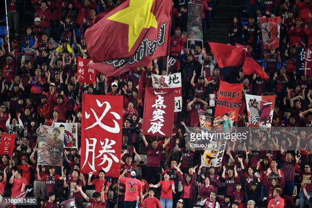 Fans of Kashima Antlers cheer after the AFC Champions League Group E match between Kashima Antlers and Shandong Luneng at Kashima Soccer Stadium on...