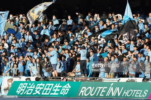 Fans of Kawasaki Frontale cheer during the JLeague MEIJI YASUDA J1 match between Kawasaki Frontale and Sagan Tosu at Todoroki Stadium on February 22...