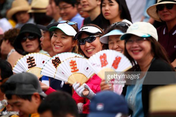 Fans of Kei Nishikori of Japan show their support during the Gentlemen's Singles first round match against Marco Cecchinato of Italy on day one of...
