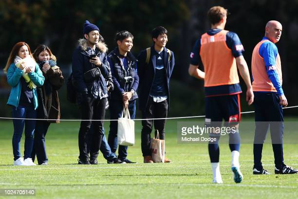 Fans of Keisuke Honda wait patiently for him during a Melbourne Victory training session at Gosch's Paddock on August 28 2018 in Melbourne Australia
