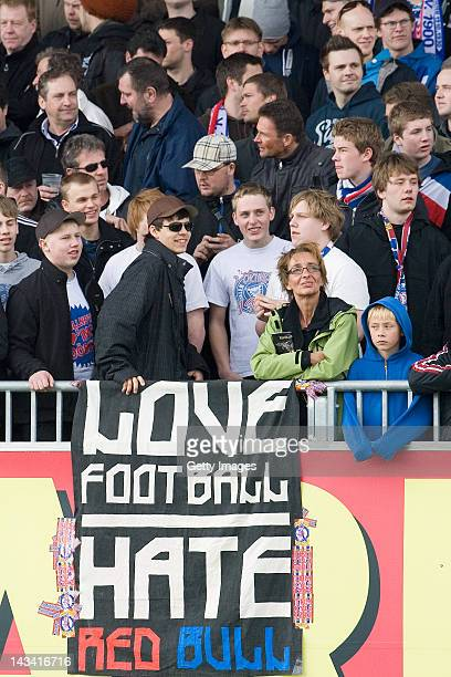 Fans of Kiel with a banner love football hate red bull during the Regionalliga Nord match between Holstein Kiel and RB Leipzig on April 21 2012 in...