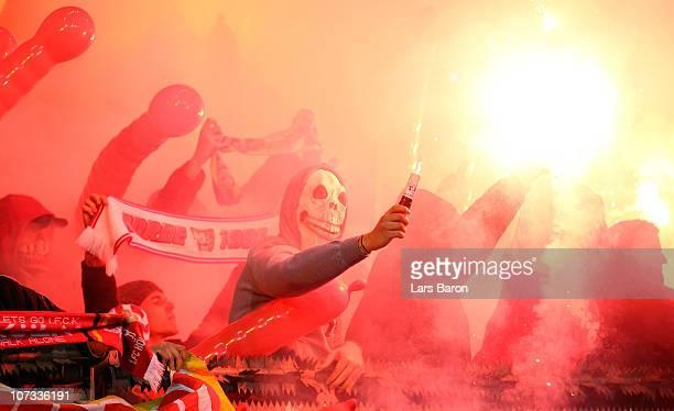 Fans of Koeln burn flares during the Bundesliga match between Bayer Leverkusen and 1 FC Koeln at BayArena on December 5 2010 in Leverkusen Germany