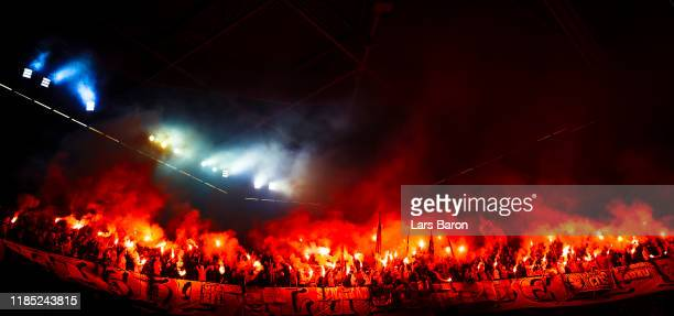 Fans of Koeln burn flares during the Bundesliga match between Fortuna Duesseldorf and 1. FC Koeln at Merkur Spiel-Arena on November 03, 2019 in...