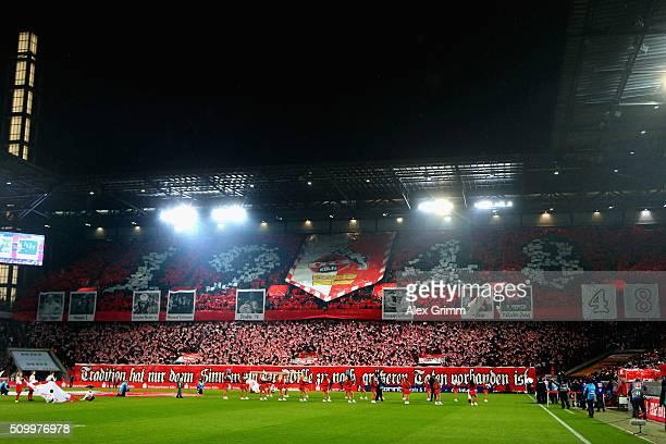 Fans of Koeln cheer prior to the Bundesliga match between 1 FC Koeln and Eintracht Frankfurt at RheinEnergieStadion on February 13 2016 in Cologne...