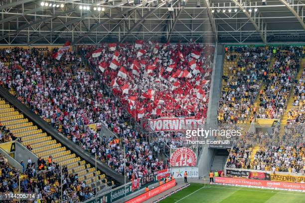 Fans of Koeln support their team during the Second Bundesliga match between SG Dynamo Dresden and 1. FC Koeln at Rudolf-Harbig-Stadion on April 21,...