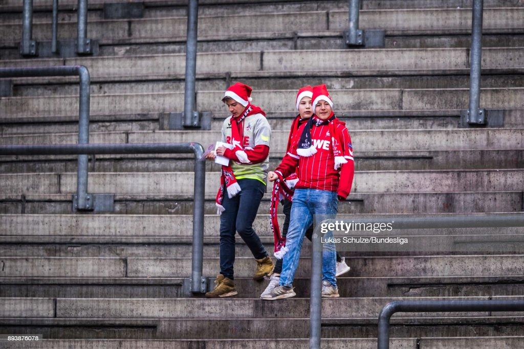 Fans of Koeln wear christmas caps prior to the Bundesliga match between 1. FC Koeln and VfL Wolfsburg at RheinEnergieStadion on December 16, 2017 in Cologne, Germany.