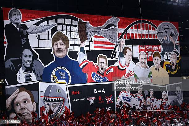 Fans of Koelner Haie show a banner during the DEL match between Koelner Haie and Krefeld Pinguine at Lanxess Arena on September 14 2012 in Cologne...