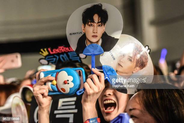 Fans of Korean pop music attend a convention called Kcon that brings together some of the most popular pop bands from Korea on June 23 2018 in Newark...