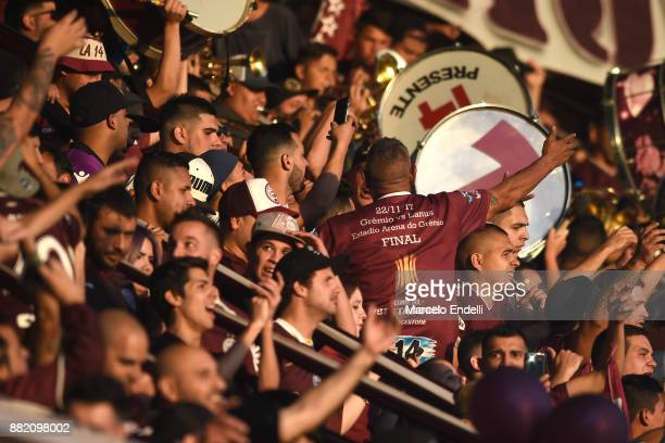 Fans of Lanus cheers for his team during the second leg match between Lanus and Gremio as part of Copa Bridgestone Libertadores 2017 Final at Ciudad...