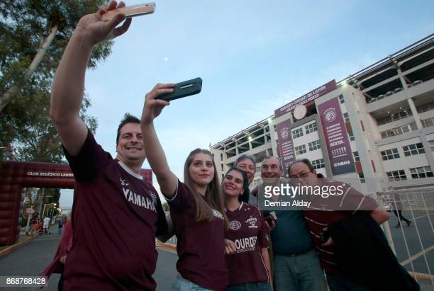 Fans of Lanus take a picture outside the stadium prior a second leg match between Lanus and River Plate as part of the semifinals of Copa CONMEBOL...