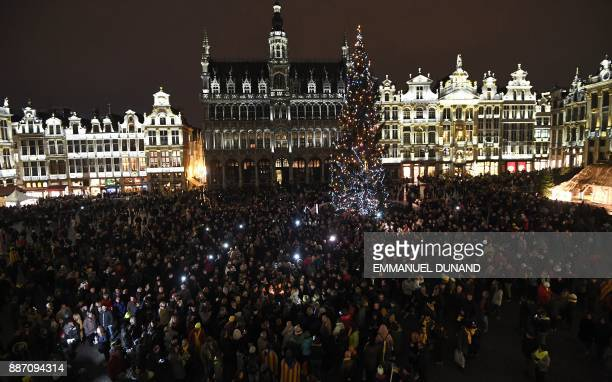 Fans of late French rock star Johnny Hallyday gather to pay their respects after the death of the singer on the Grand Place in Brussels on December 6...