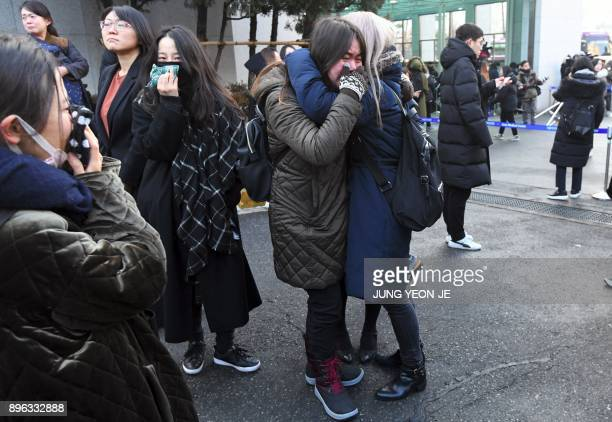 Fans of late SHINee singer Kim JongHyun cry as the hearse carrying the body of Kim leaves from a hospital in Seoul on December 21 2017 Kim a...
