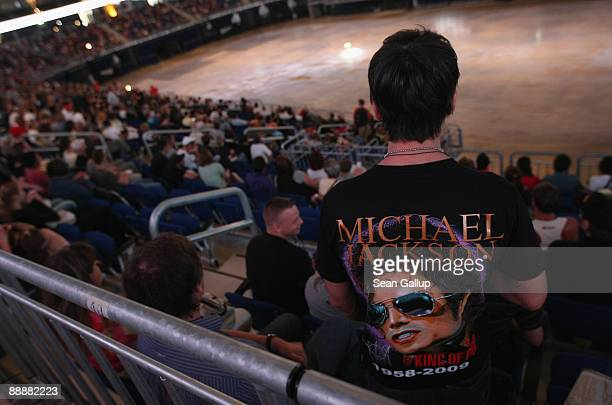 Fans of late US popstar Michael Jackson arrive to watch a live broadcast of Jackson's funeral at the O2 Arena on July 7 2009 in Berlin Germany An...