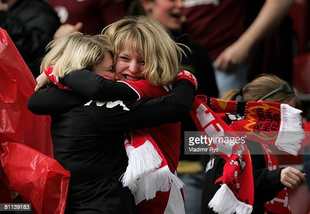 Fans of Lautern celebrate during the Bundesliga match between 1 FC Kaiserslautern and 1 FC Koeln at the FritzWalterStadium on May 18 2008 in...