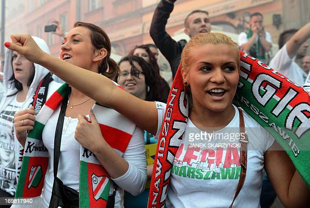 Fans of Legia Warszawa celebrate their club's victory and winning the champion of Poland title on June 2 2013 in the old town in Warsaw AFP...