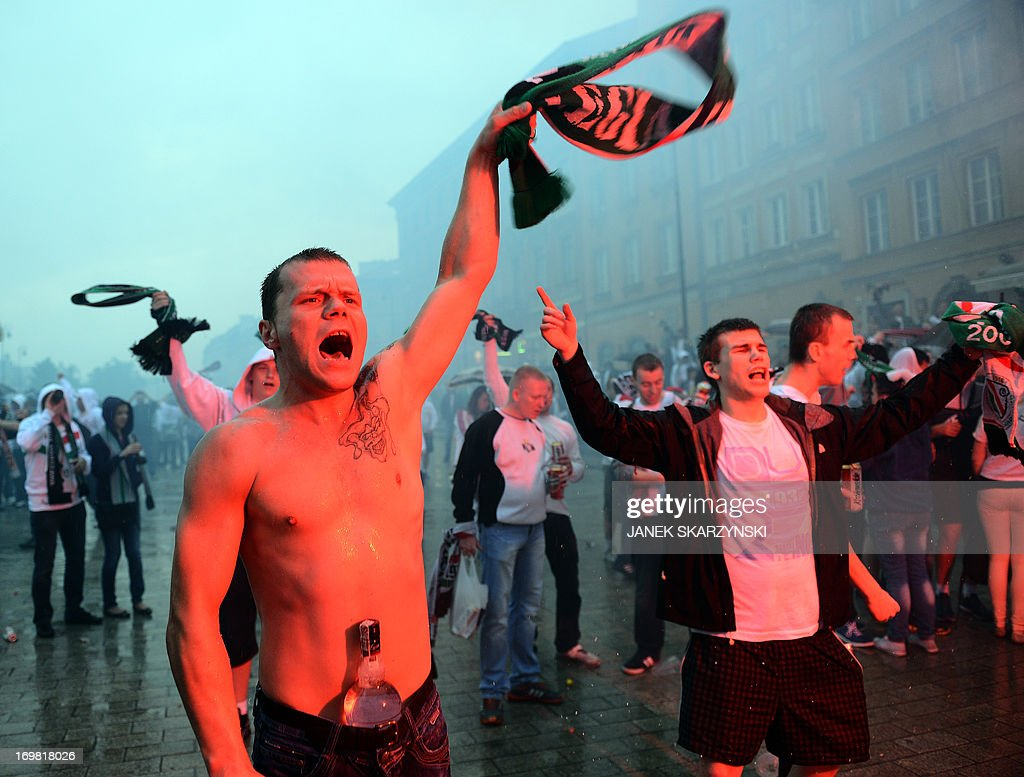 Fans of Legia Warszawa celebrate their club's victory and winning the champion of Poland title on June 2, 2013 in the old town in Warsaw.